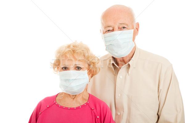 Járvány idős pár aggódó visel sebészi maszkok Stock fotó © lisafx