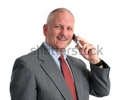 Happy Businessman On Cell Phone Stock photo © lisafx