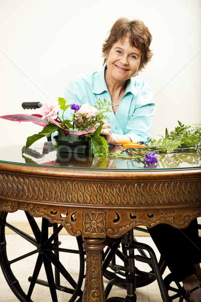 Disabled Woman Arranging Flowers Stock photo © lisafx