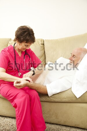 Home Nurse Takes Blood Pressure Stock photo © lisafx