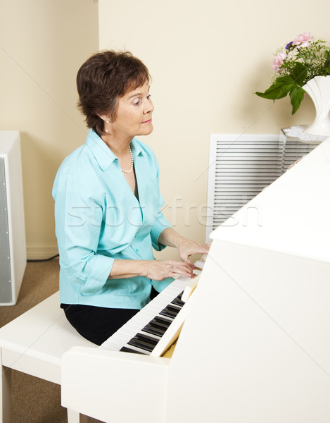 Pianist Playing Church Hymns Stock photo © lisafx