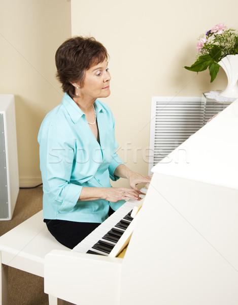 Zongorista játszik templom zongora nő zene Stock fotó © lisafx