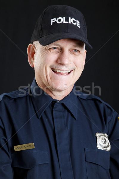 Rendőr portré barátságos nevet stúdiófelvétel fekete Stock fotó © lisafx