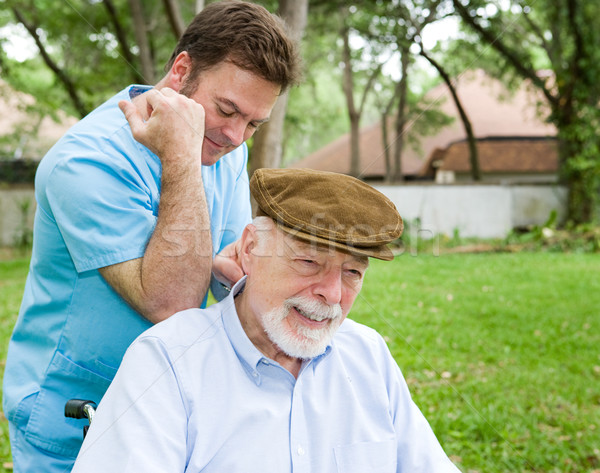 Massaggio terapeuta client senior indietro Foto d'archivio © lisafx