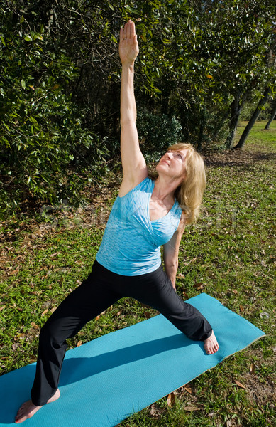 Mature Woman Yoga - Upward Warrior Stock photo © lisafx