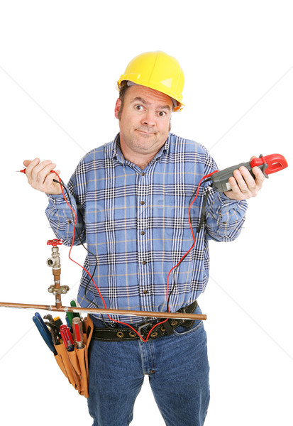 Stock photo: Electrician Confused by Plumbing