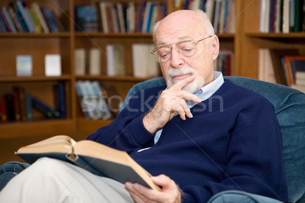 Interessante leitura senior homem sessão Foto stock © lisafx