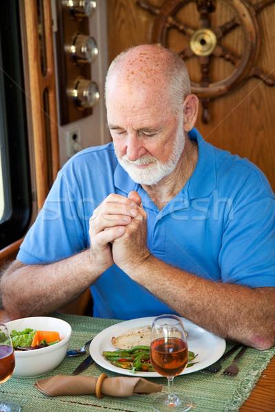 RV Senior Man Says Grace Stock photo © lisafx