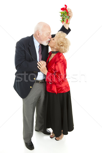 Stock photo: Romantic Seniors Under Mistletoe