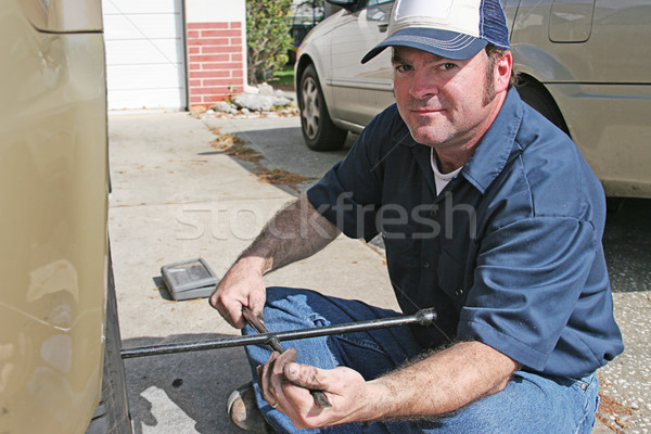 Mechanic Using Tire Iron Stock photo © lisafx