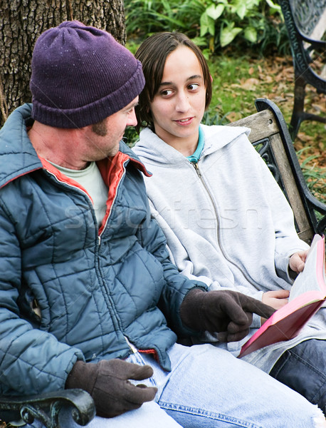 Homeless Family with Bible Stock photo © lisafx