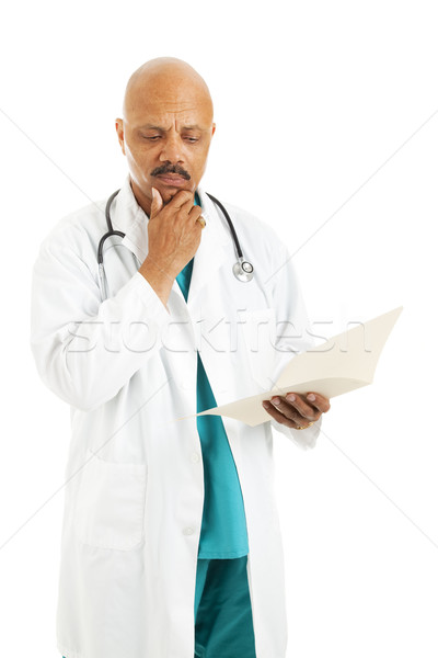 Doctor Reviews Patient Chart Stock photo © lisafx