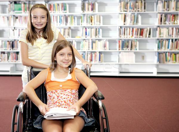Okul kütüphane iki kızlar bir mutlu Stok fotoğraf © lisafx