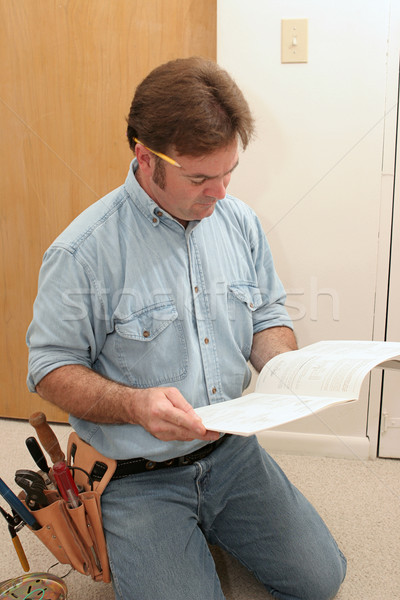 Electrician Reads the Manual Stock photo © lisafx