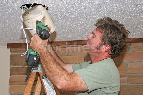 Electrician Removing Light Stock photo © lisafx