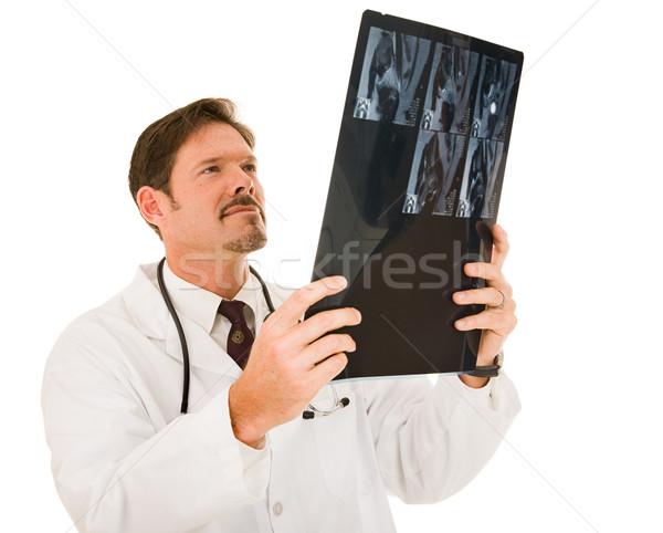 Guapo médico mri examinar resultados aislado Foto stock © lisafx