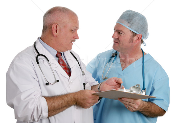 Medical Resident Instructs Intern Stock photo © lisafx