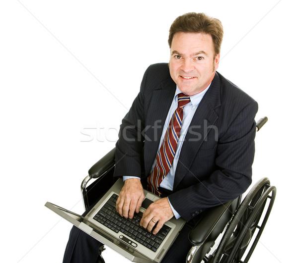 Foto stock: Inválido · empresário · computador · datilografia · computador · portátil · isolado