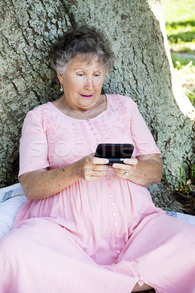 Senior Woman Confused by Texting Stock photo © lisafx