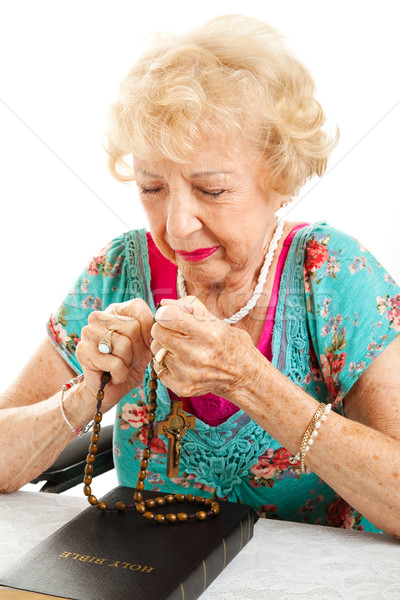 Senior Woman Saying the Rosary Stock photo © lisafx