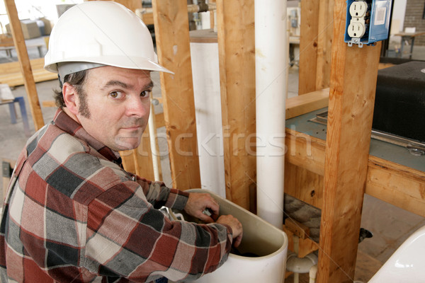 Plumber Working in Toilet Tank Stock photo © lisafx