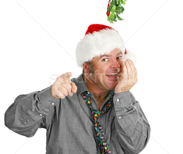 Creepy Guy Checking Breath Under Mistletoe Stock photo © lisafx