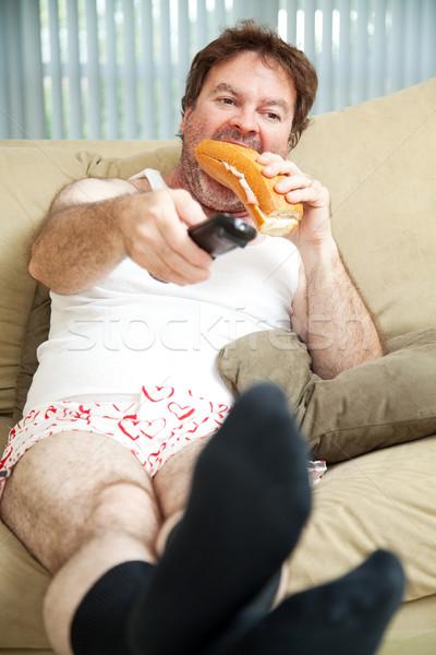 Lusta nap otthon állástalan férfi ül Stock fotó © lisafx