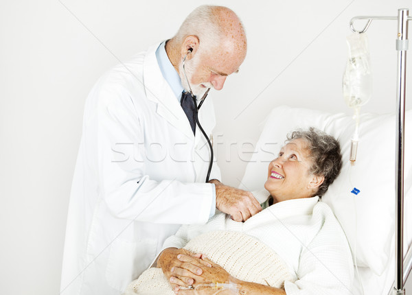 Medical Exam from Handsome Doctor Stock photo © lisafx