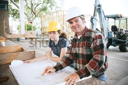 Emploi construction blueprints Homme apprenti affaires Photo stock © lisafx