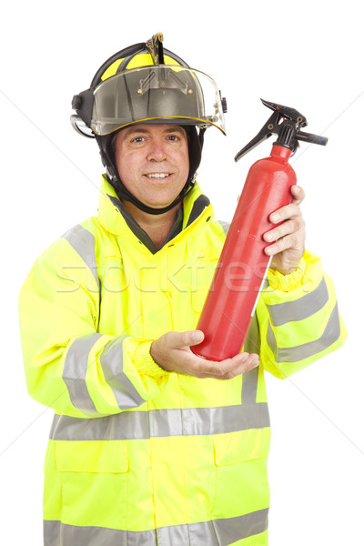 Fireman Demonstrates Fire Extinguisher Stock photo © lisafx