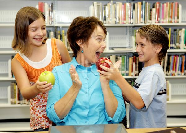 Favori enseignants deux élèves pommes étonné Photo stock © lisafx