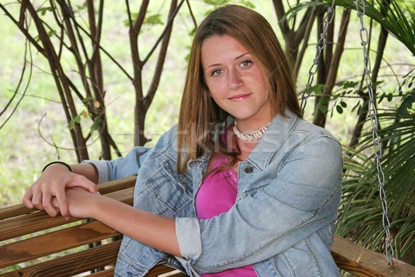 Rahatlatıcı sundurma güzel genç kız oturma salıncak Stok fotoğraf © lisafx