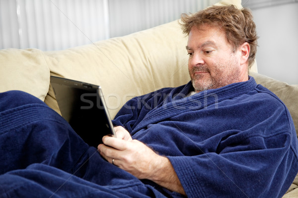 Casual Man Using Tablet PC  Stock photo © lisafx