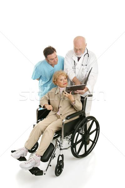 Mozgássérült idős doksik nő tolószék megbeszél Stock fotó © lisafx