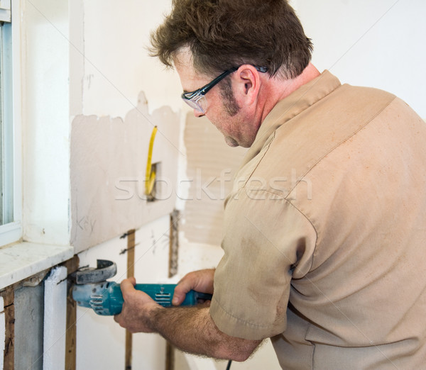 Electrician Using Grinder Stock photo © lisafx
