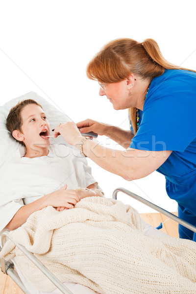 Nurse Looks in Childs Throat Stock photo © lisafx