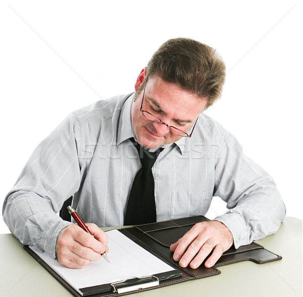 Businessman Writing on Legal Pad Stock photo © lisafx