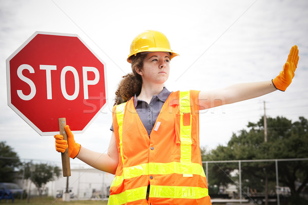 Stock photo: Female Construction Worker Directs Traffic