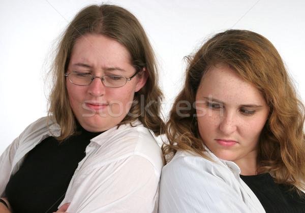 Broer rivaliteit twee aantrekkelijk zusters beide Stockfoto © lisafx