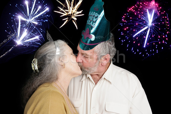 Nuevos año beso medianoche hermosa pareja de ancianos Foto stock © lisafx