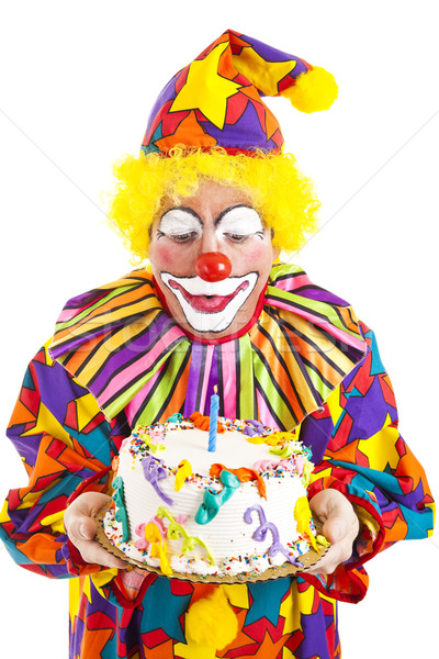 Clown Blows Birthday Candle Stock photo © lisafx