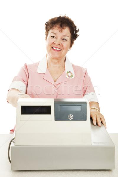 Przyjazny uśmiechnięty kasjer za kasa biały Zdjęcia stock © lisafx