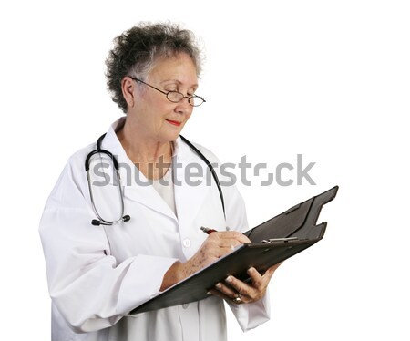 Mature Female Doctor Taking Notes Stock photo © lisafx