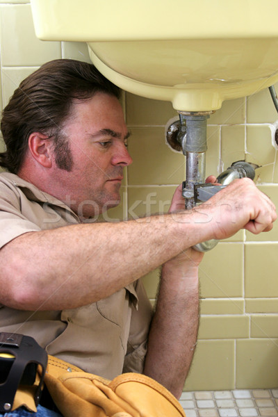 Plumber Using Pipe Wrench Stock photo © lisafx