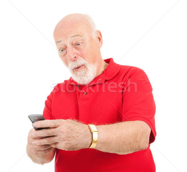 Senior Man - Surprising Text Message Stock photo © lisafx