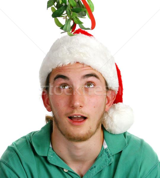 Surprised Young Man Under Mistletoe Stock photo © lisafx