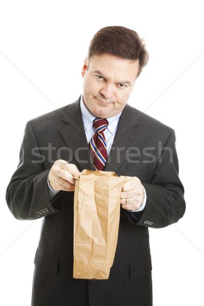Empresário chato almoço desapontado saco Foto stock © lisafx
