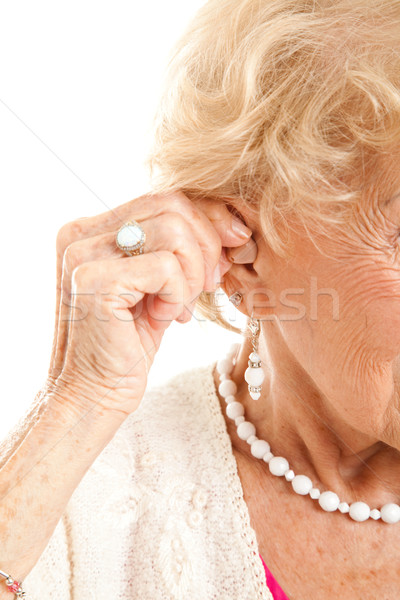 Inserting Hearing Aid Stock photo © lisafx