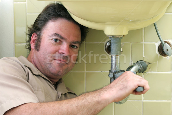 Plumber Working Under Sink Stock photo © lisafx