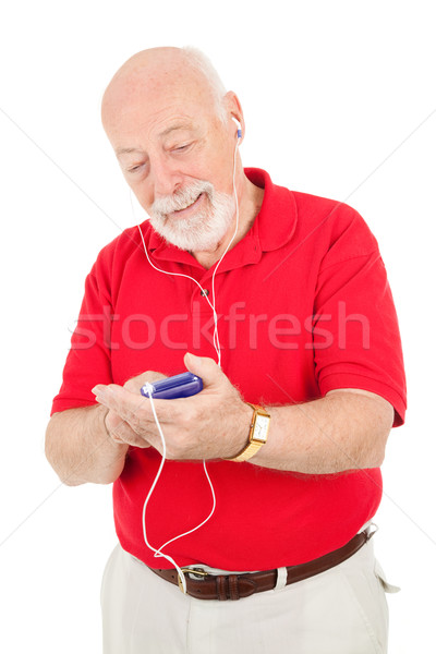 Senior Man Using MP3 Player Stock photo © lisafx